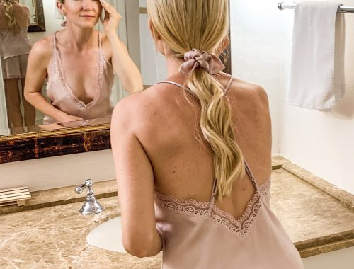 Woman washing her face in the bathroom