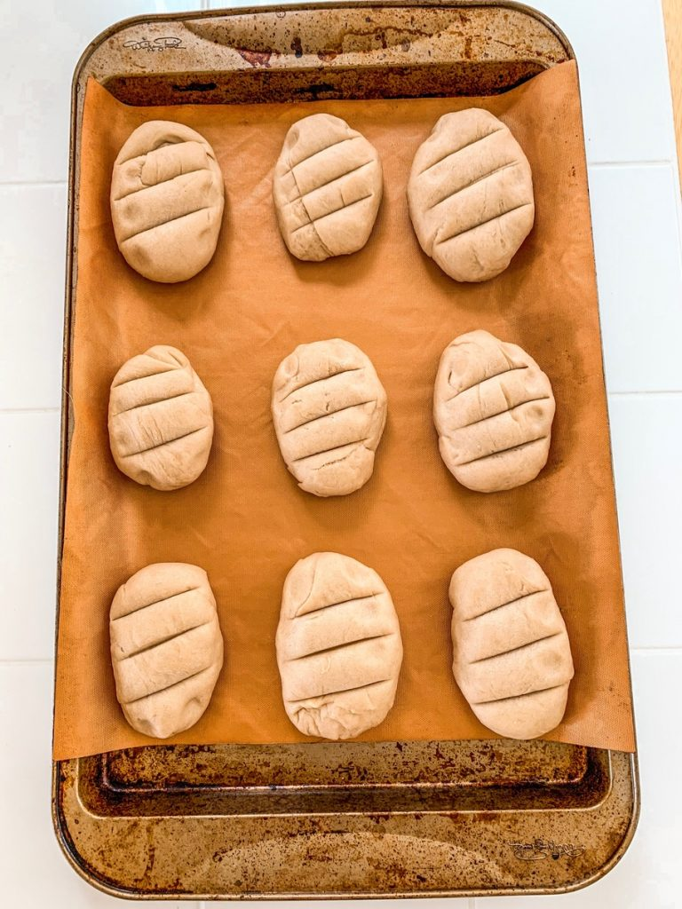 Breakfast rolls ready to bake on a baking tray